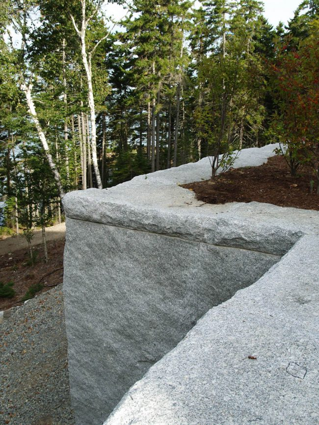 Split face Freshwater Pearl granite wall, with rock face coping