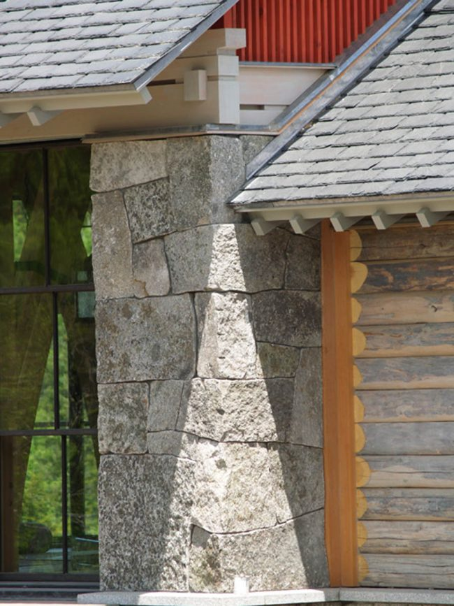 Weathered, split face Freshwater Pearl granite stone on houses