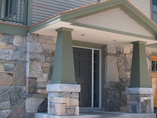 Weathered granite stone on houses and column bases