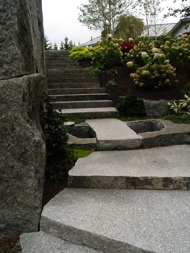 Thermal Freshwater Pearl granite steps with weathered edges, and a weathered Freshwater Pearl granite wall