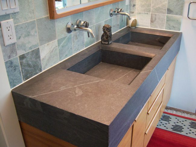 Honed Soapstone vanity with custom, carved sink basins