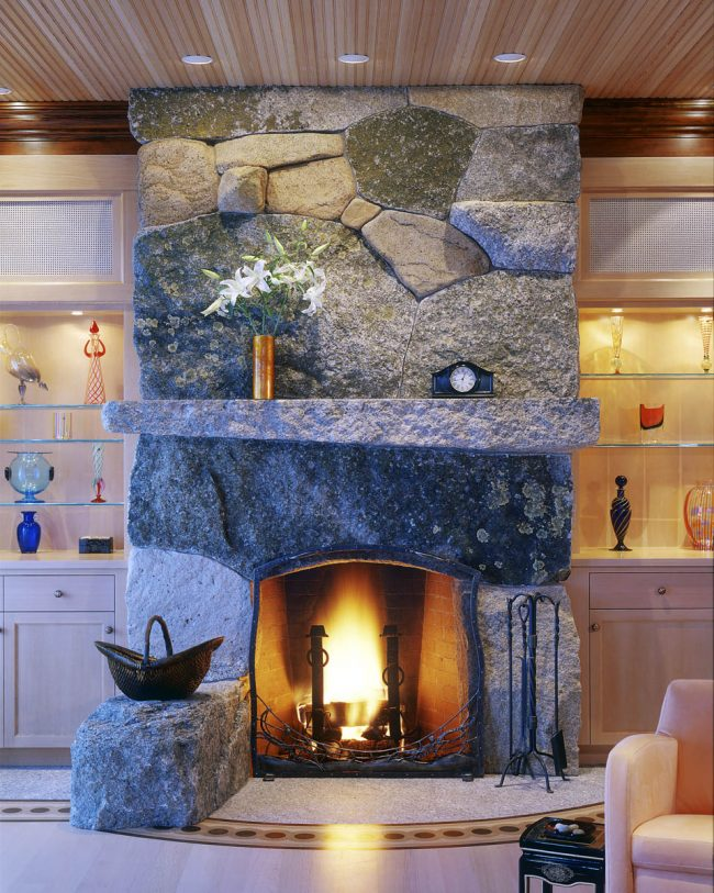 Weathered granite fireplace - Photo by Brian Vanden Brink