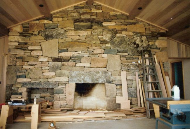 1988 Fireplace featuring stacked beach stones