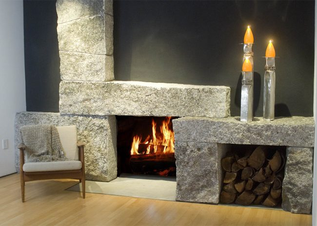 Weathered Freshwater Pearl granite fireplace, with wood box