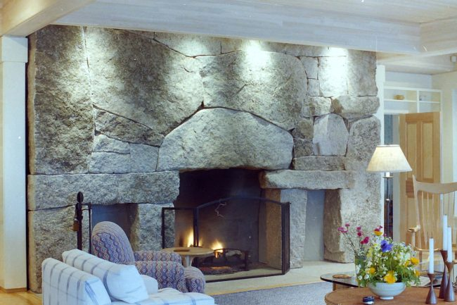 Weathered Freshwater Pearl granite fireplace, with two wood boxes