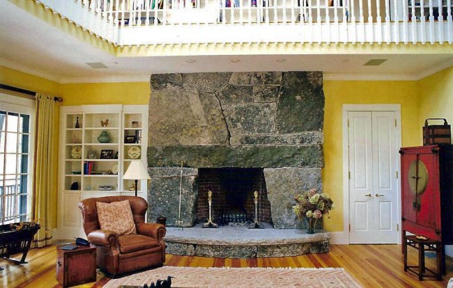 Weathered granite fireplace with a raised, rock face hearth stone