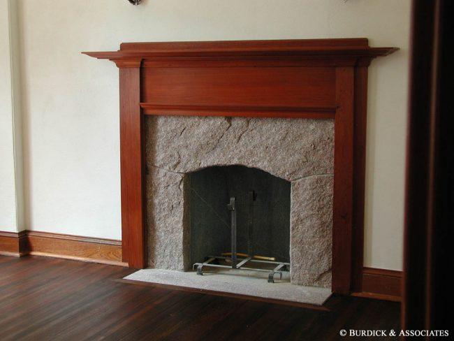Split face granite fireplace with flush hearth stone