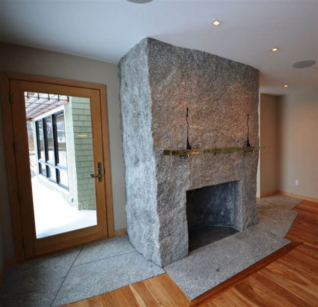 Freshwater Pearl granite block fireplace with flush hearth stone
