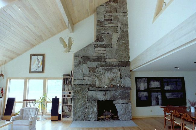 Weathered granite fireplace, with a flush hearth stone
