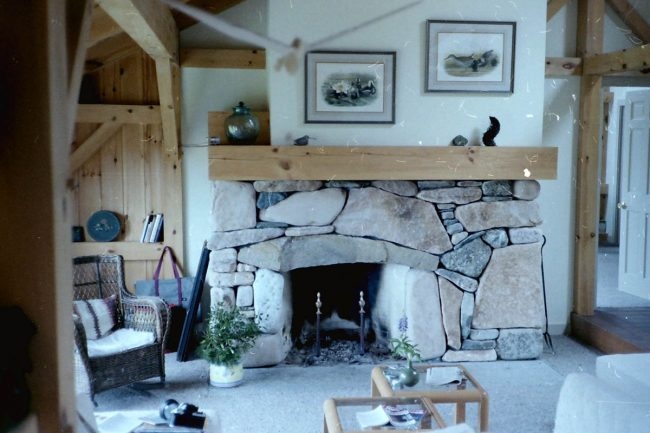 Weathered field stone fireplace