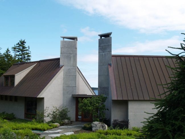 Modern, triangular Freshwater Pearl granite chimneys, with triangular chimney caps