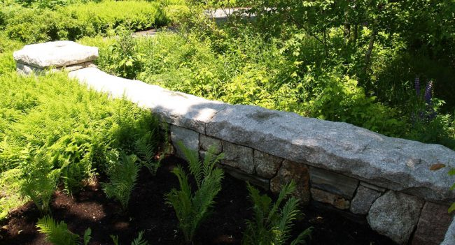 Weathered granite wall with rock face Freshwater Pearl granite coping