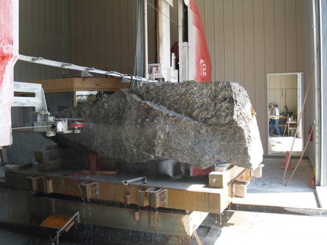 Our Pellegrini single wire saw, cutting massive slabs from a block of stone