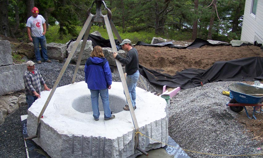 Installation of the base of a Freshwater Pearl granite hot tub