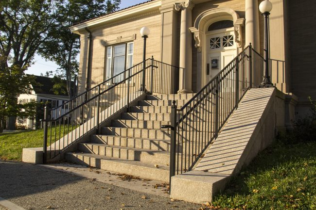 Historical restoration on granite railings and facade