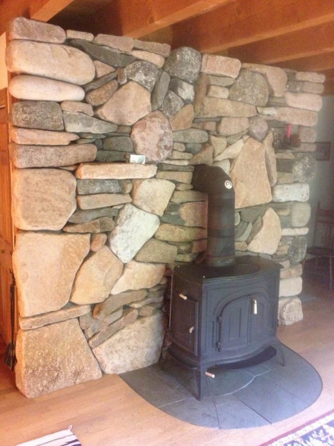 Multi-color, field stone interior wall