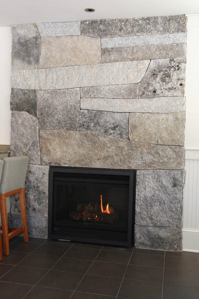 Weathered granite fireplace, flush with the wall