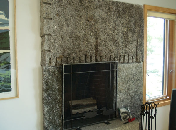 Weathered, Freshwater Pearl granite fireplace, with drill holes
