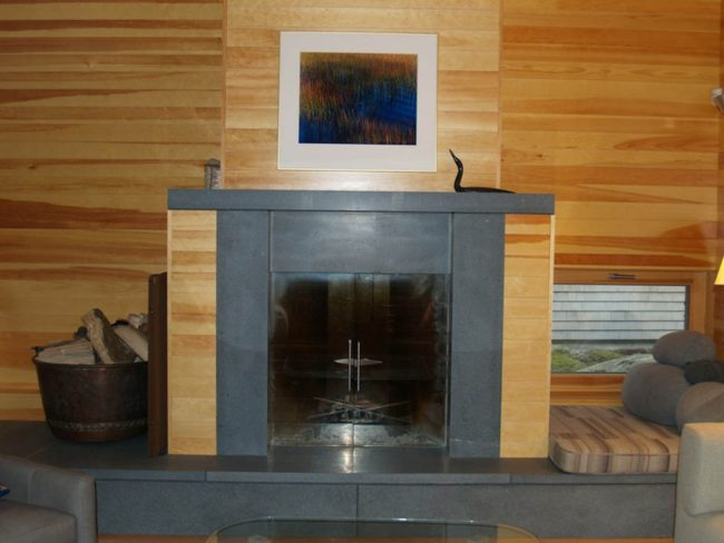 Modern, black granite fireplace