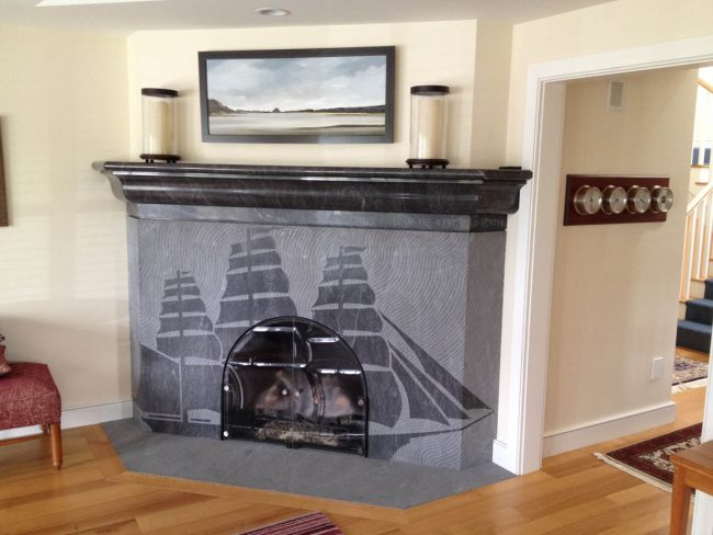 Engraved soapstone fireplace, with a flush hearth stone