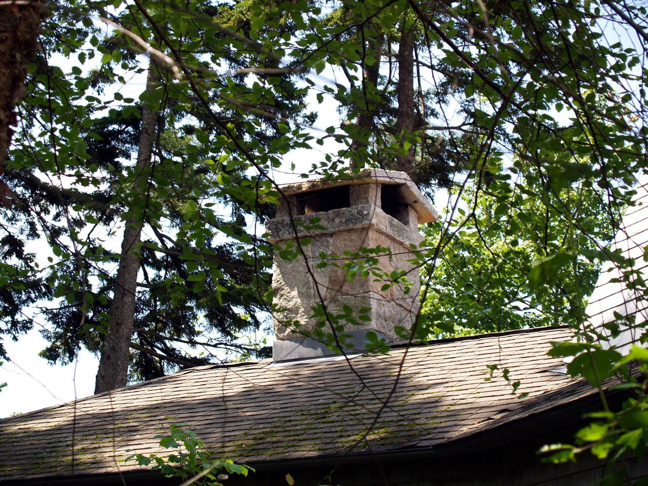 Granite chimney with a custom chimney cap