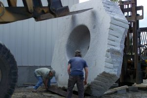 Freshwater Stone crew members preparing the base of a custom hot tub for installation