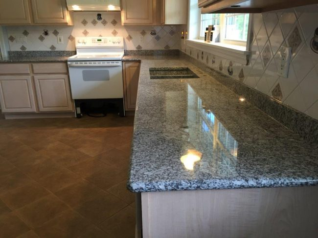Polished Freshwater Pearl granite countertop with a bullnose edge profile