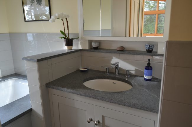 Honed Morning Mist granite vanity top and shelving