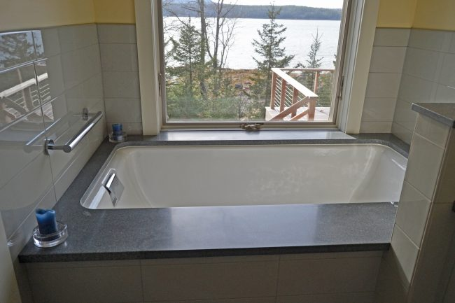 Honed Morning Mist granite tub deck