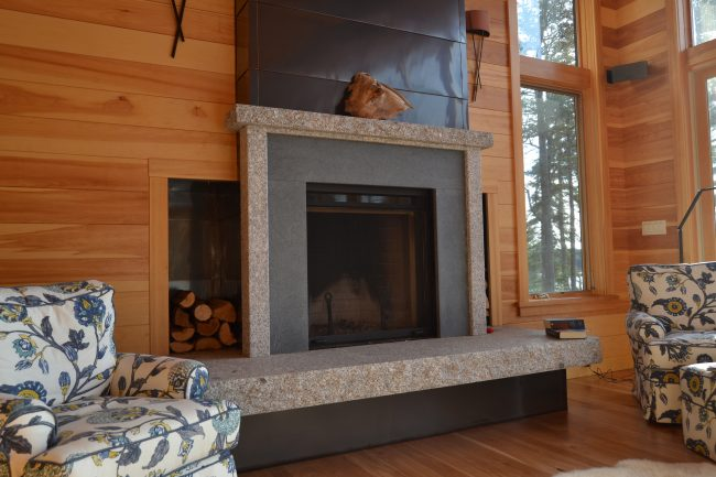 Freshwater Pearl granite and gray soapstone fireplace