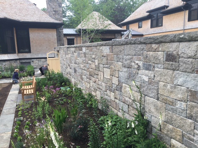 Weathered ashlar wall with a rock face wall cap