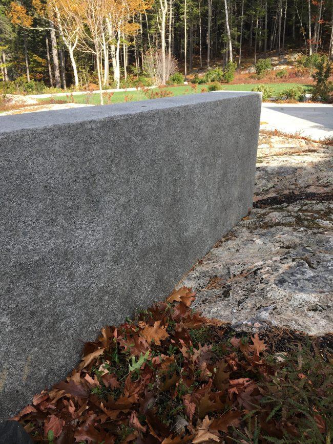 Split face Freshwater Pearl granite knee wall