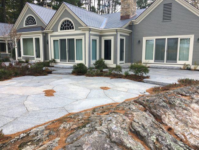 Irregular Freshwater Pearl granite pavers and Freshwater Pearl granite steps with a rock face edge
