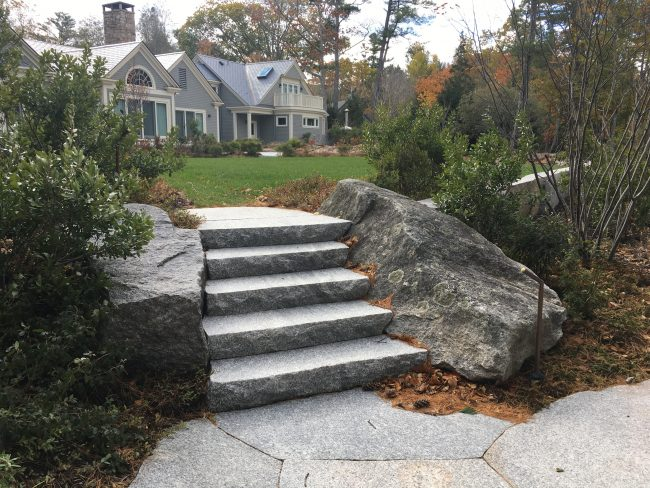 Freshwater Pearl granite steps with a rock face edge fitted between two weathered Freshwater Pearl boulders.