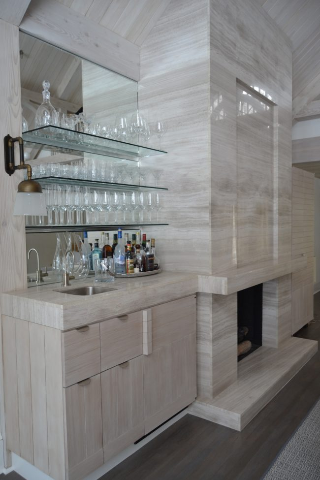 Honed Silk Georgette marble fireplace surround with connected bar top.