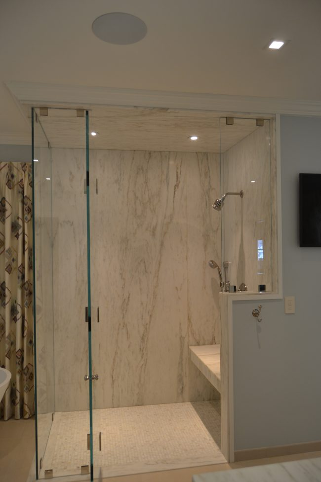 Honed Imperial Danby shower walls and ceiling, with shower seat and thresholds.