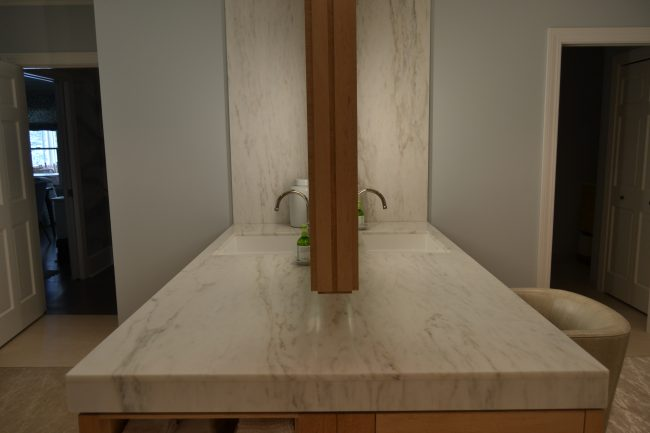 Honed Imperial Danby marble vanity top with full height side splash