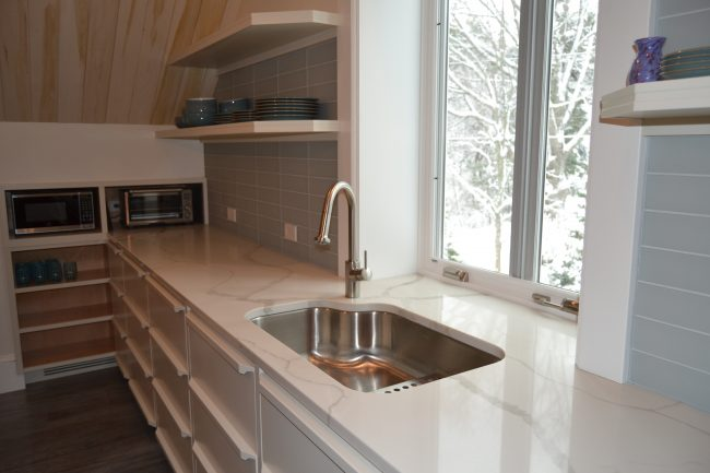 Polished Calacatta Novus quartz countertops with book matched veining.