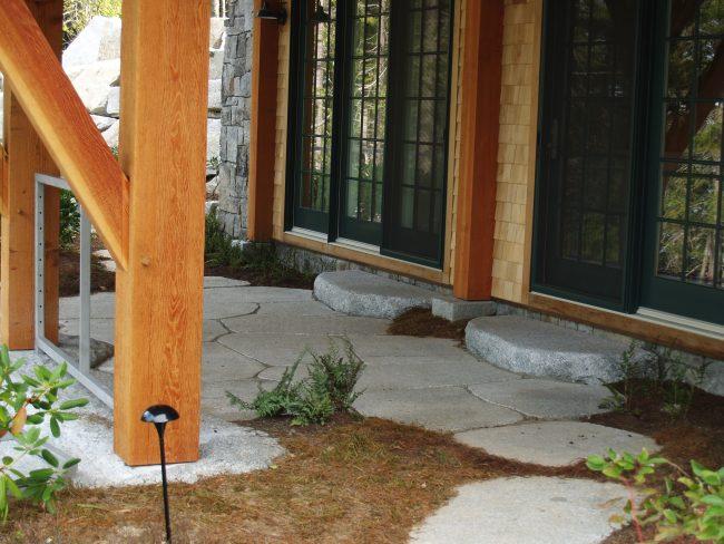 Irregular, thermal Freshwater Pearl granite pavers with irregular landings