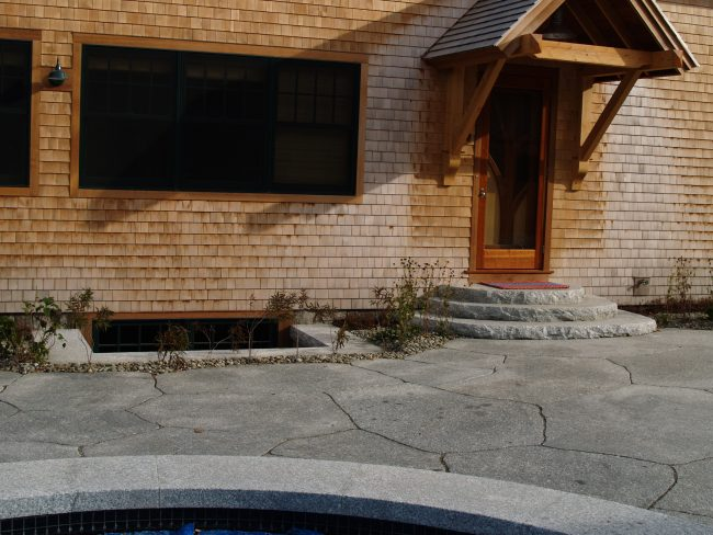 Irregular Freshwater Pearl granite pavers with rounded, rock face steps