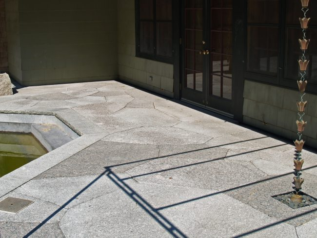 Cracked ice patios pavers in Freshwater Pearl, Deer Isle, and Polychrome granites