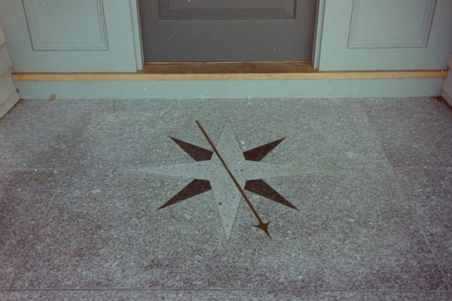 Deer Isle granite pavers with a custom compass rose design